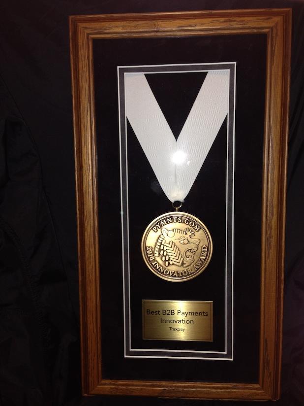 Photo of TRAXPAY GEWINNT PYMNTS.COM 2014 INNOVATION AWARD